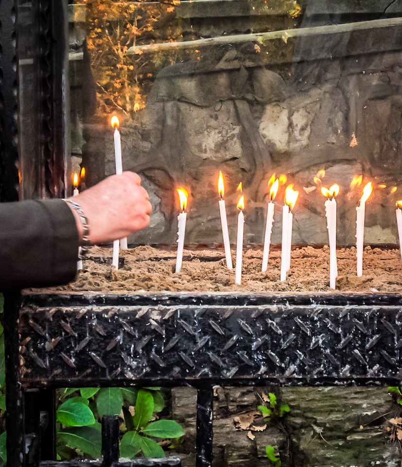 Lighting a Candle at Mary's Shrine